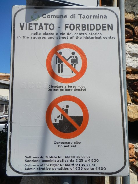I'm not sure why you can't eat in Taormina - or what that sign even means.  Perhaps it means no picnics on the streets.